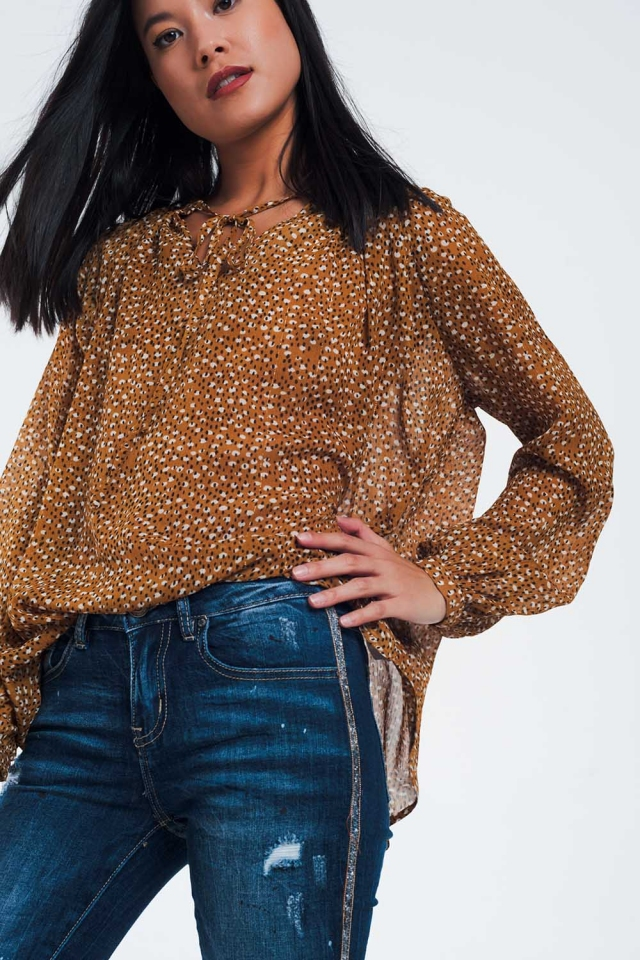 Thin mustard coloured blouse with v-neck