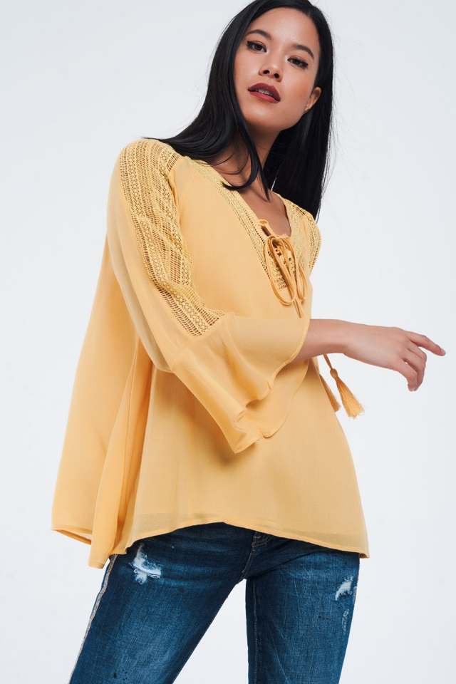 Mustard tunic with crochet details