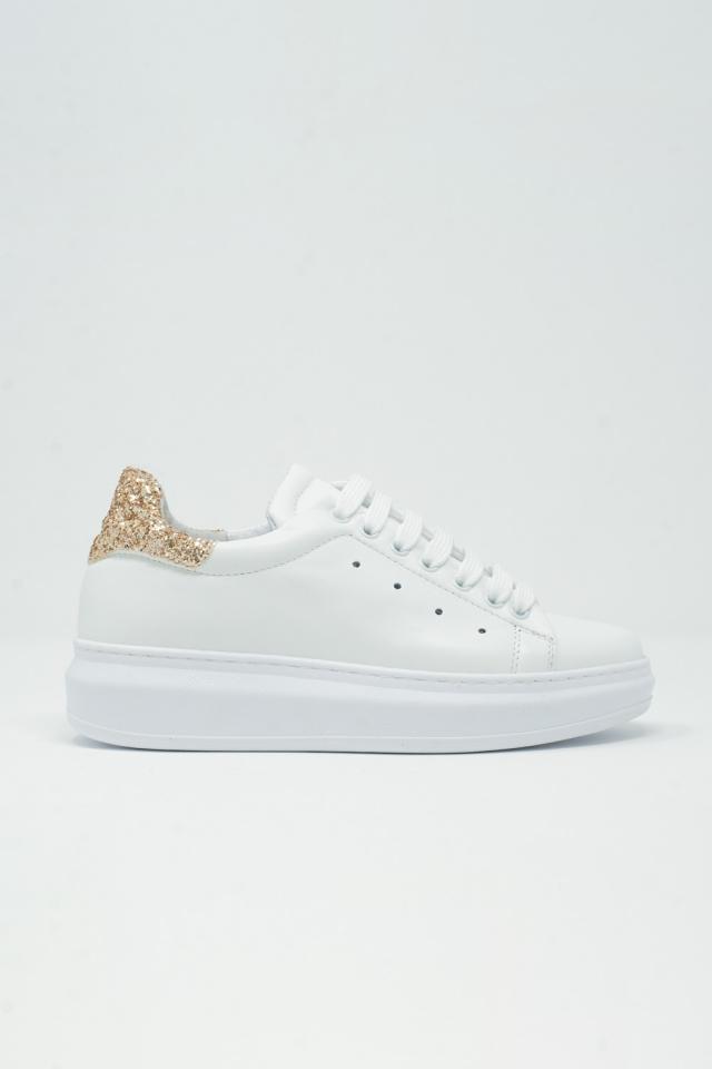 Sneakers met dikke zool in wit en gouden glitter