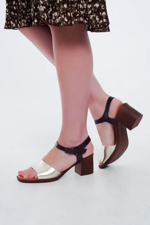 Gold sandals with block heel and ankle fastening