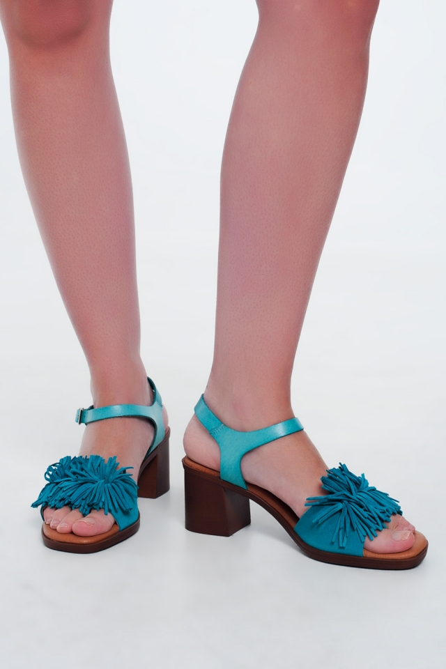 Heeled sandals with ruffles in Turquoise