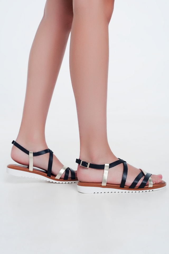 Flat sandals with cross over straps and ankle ties in black