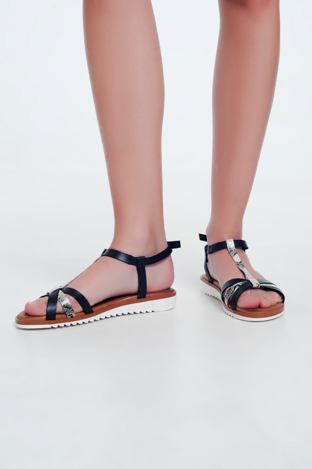 Black coloured wedge sandals