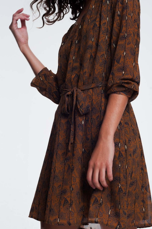 dress with a waist belt in jacquard print
