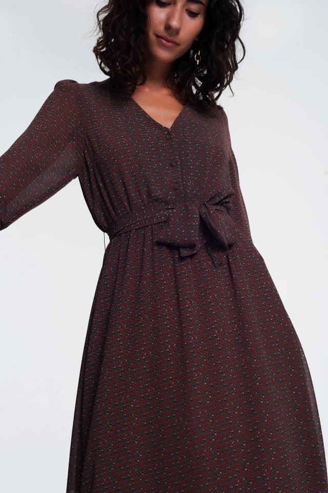 long sleeve button through brown dress with a shirred waist