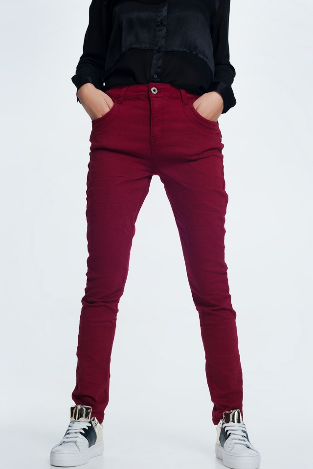 Drop crotch skinny jean in maroon