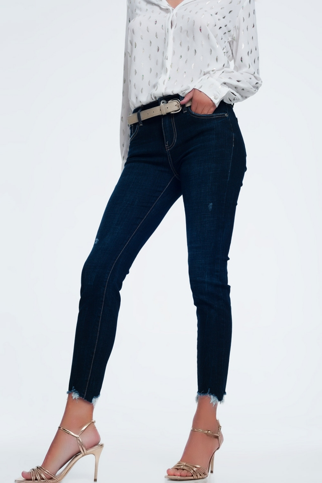 mid rise jeans in bright blue with raw hem