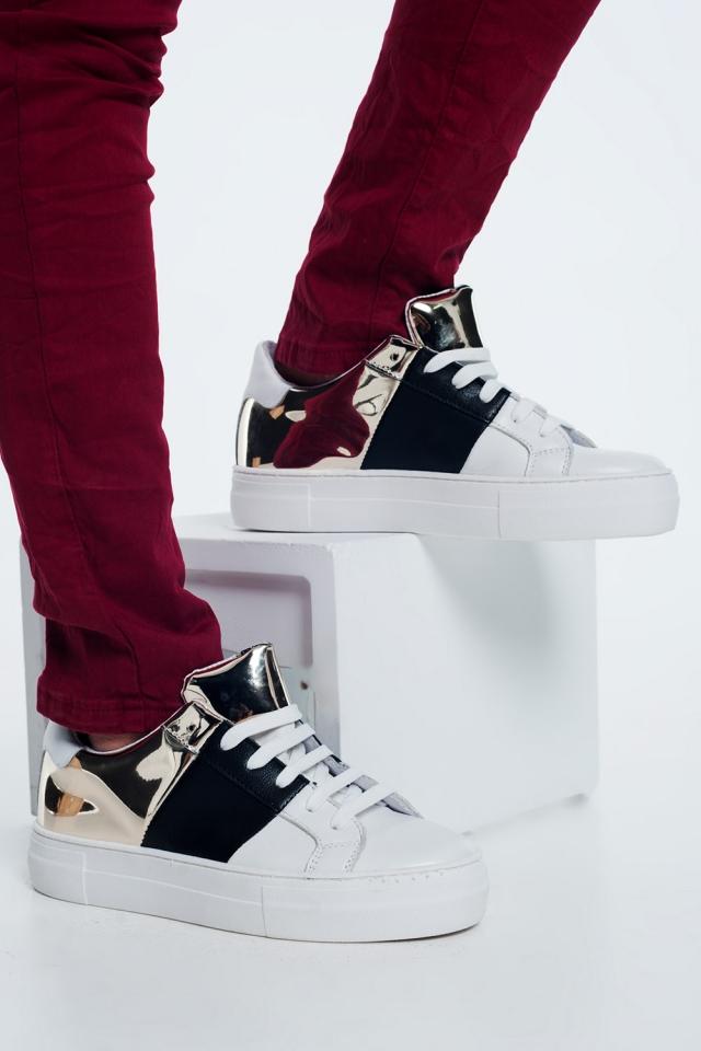 Sneakers met dikke zool in zwart en goud