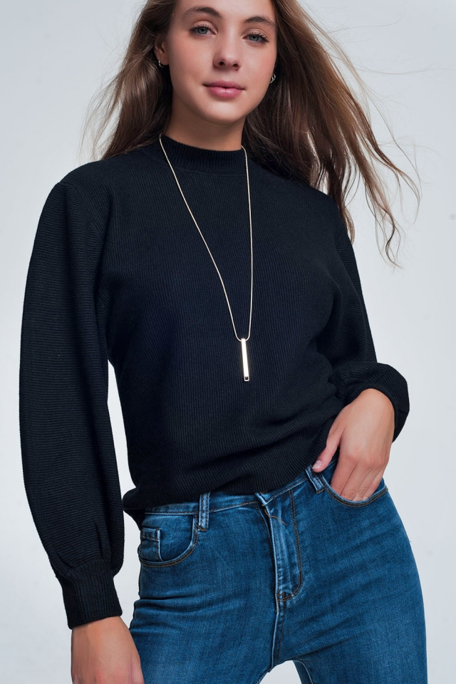 Black sweater with round neck and long sleeves
