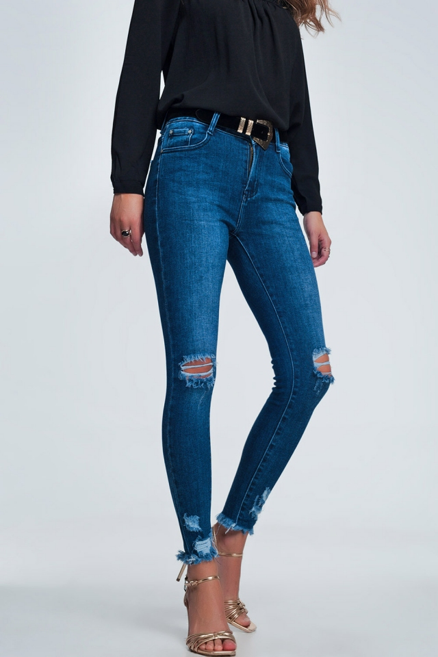 Blue skinny jeans with cracks