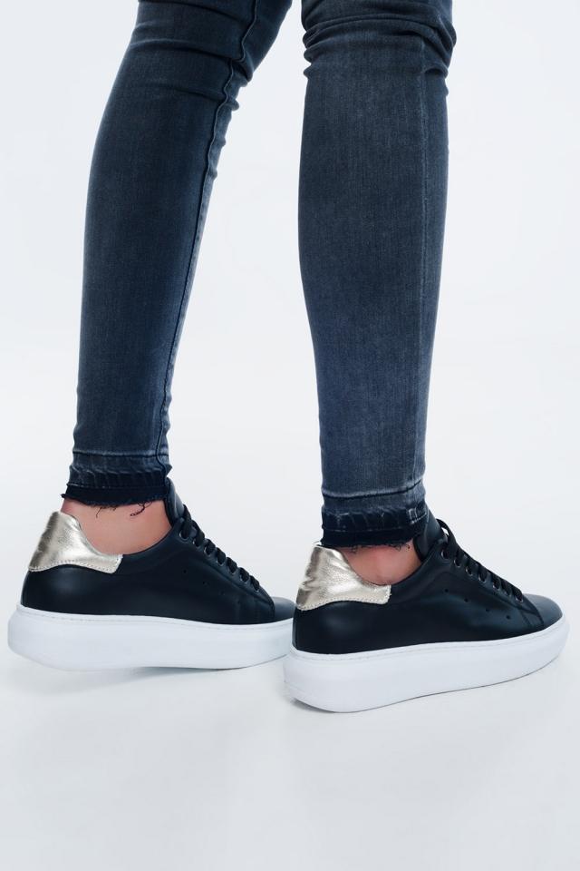Black sneaker with golden detail