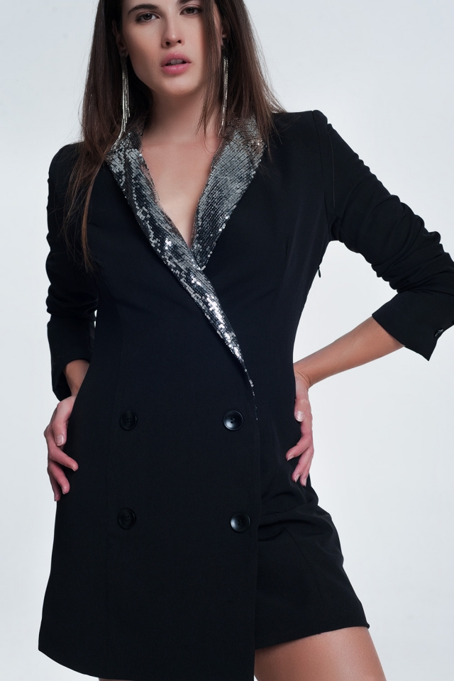 Black mini dress with shiny detail by the collar