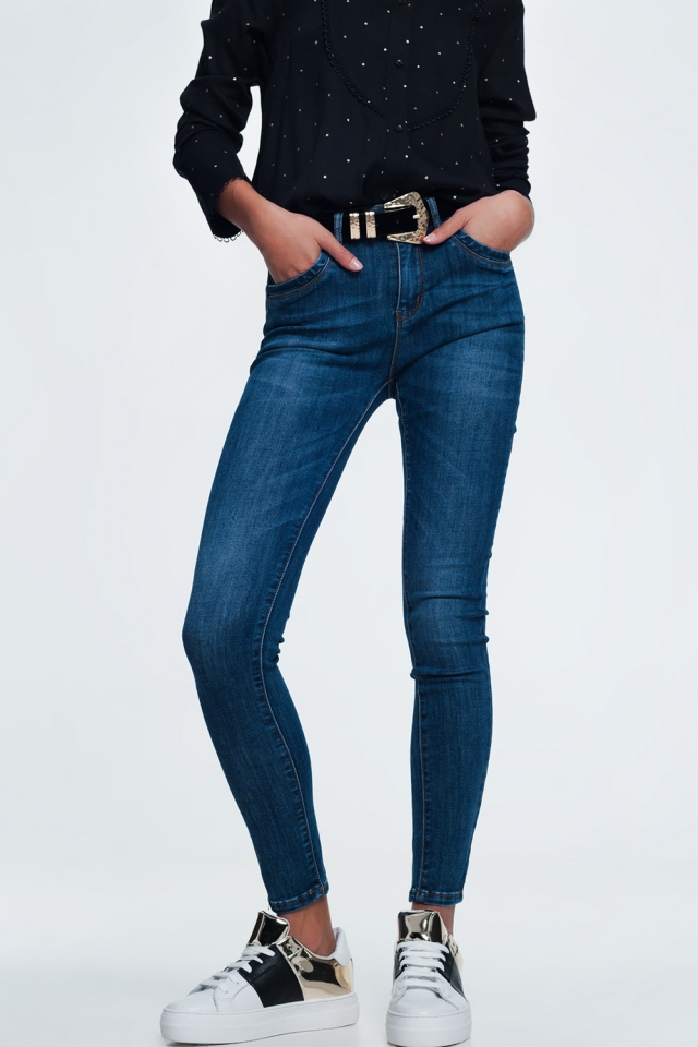 Blue skinny jeans in mid dark wash