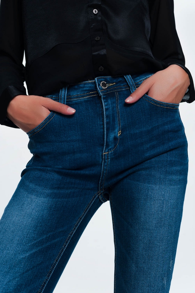 Blue skinny jeans in mid wash