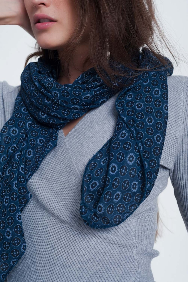 Blue-colored scarf with a print of circles