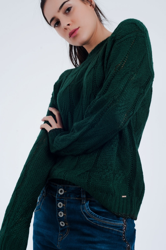 Green sweater with cable knit detail