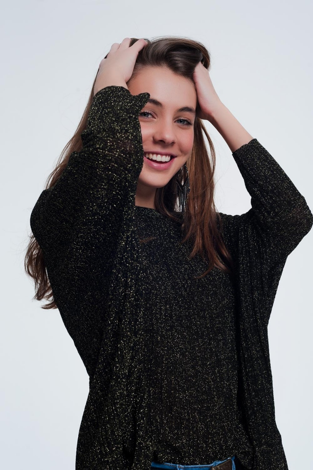 Black sweater with gold shiny detail