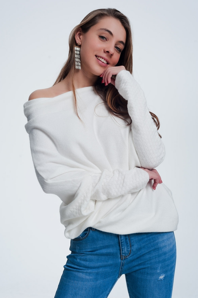 Cream sweater with long sleeves