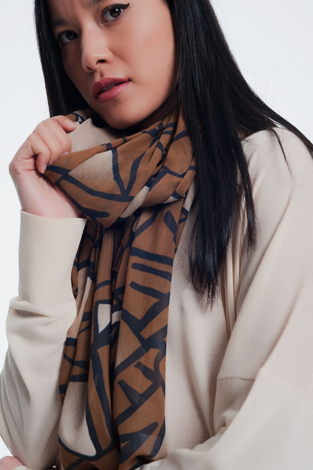 Beige scarf with patterns