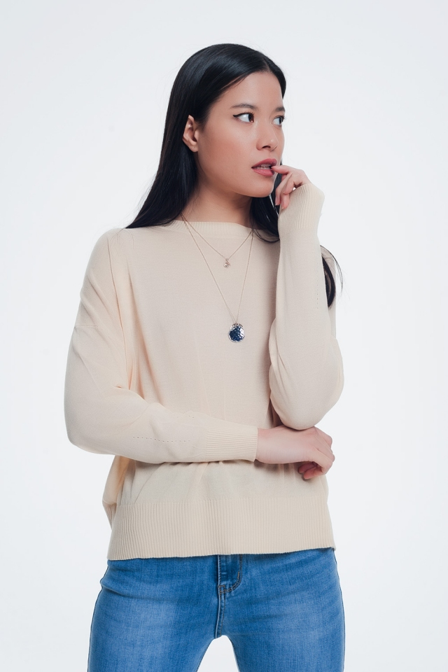 Classic beige sweater with striped edges