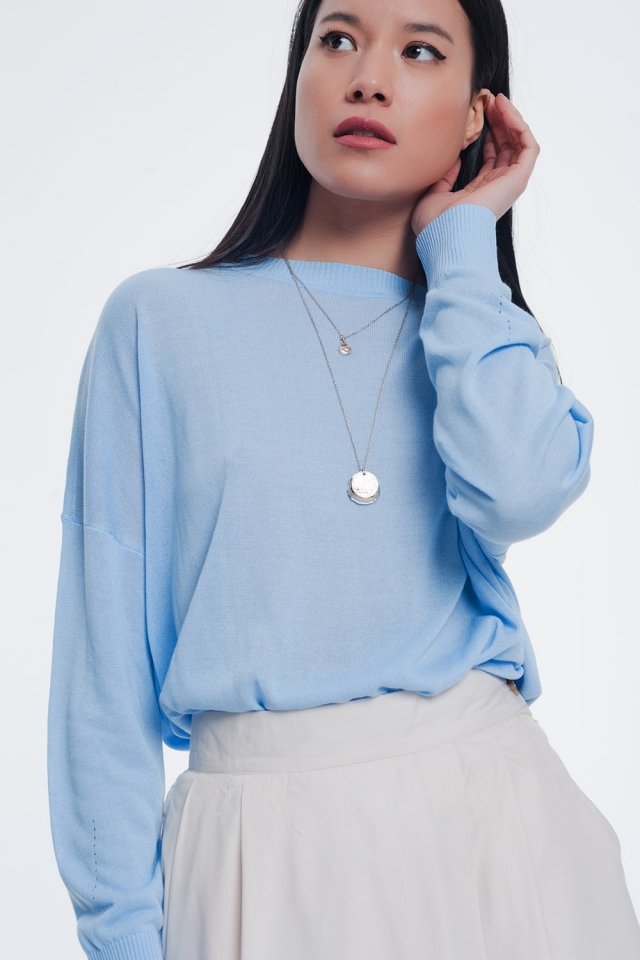 Classic blue sweater with striped edges