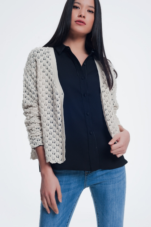 Cream cropped cardigan with knit pattern details