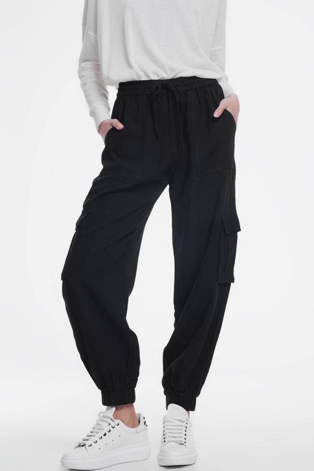 Black cargo pants with elastic ankles