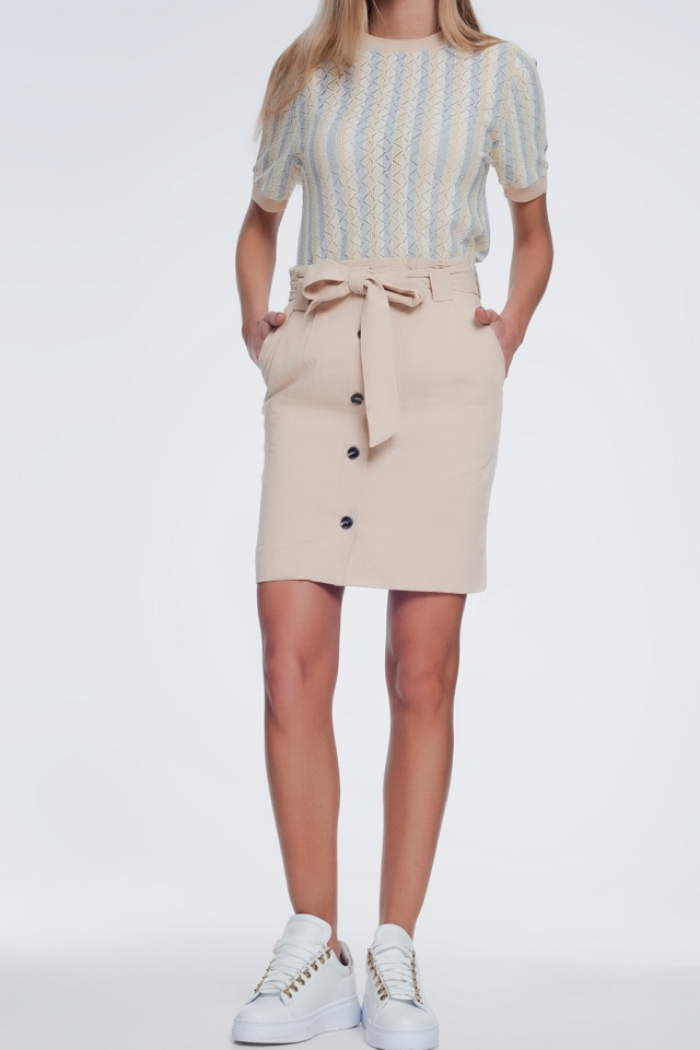 Mini beige skirt with front buttons