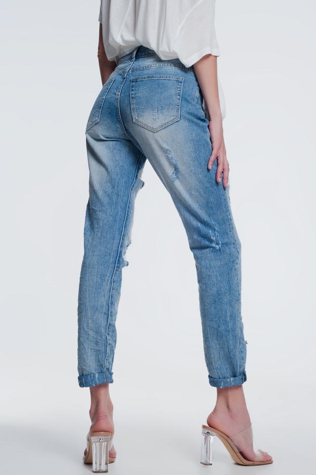 Heavily torn straight jeans in light denim
