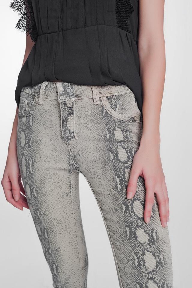 beige super skinny reversible pants with snake print