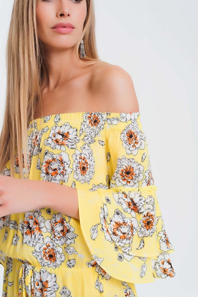 Yellow jumpsuit with flower print