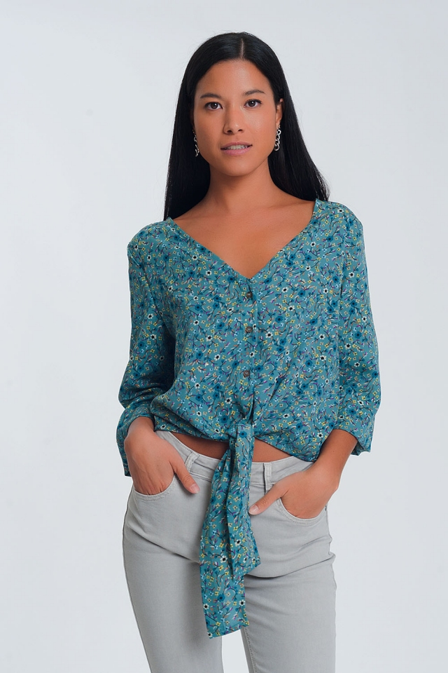 Long sleeve v neck blouse with button detail in green floral print