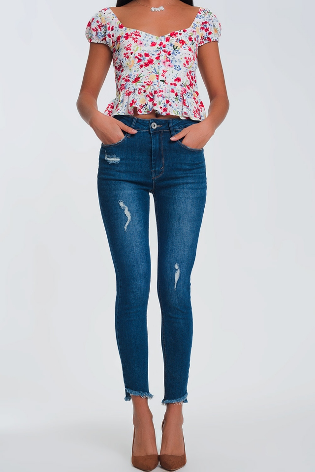 Straight jeans with ankle detail and wear in light denim