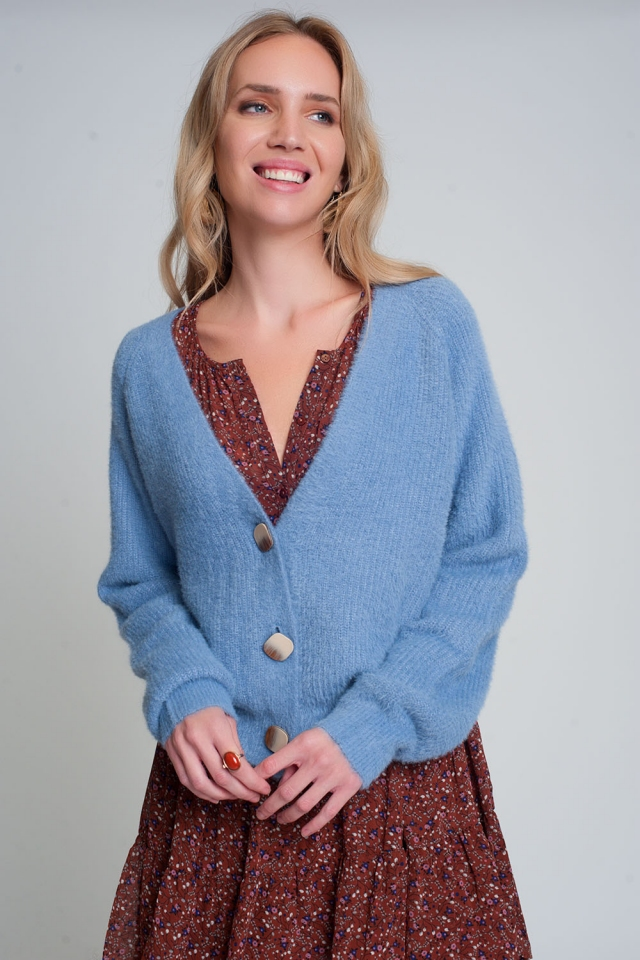 Soft cardigan with buttons and deep v neck in blue