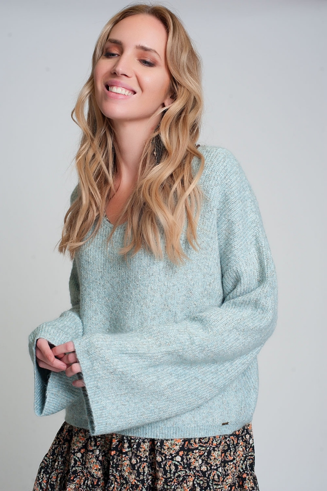 Wide sleeve sweater in green ribbed knit