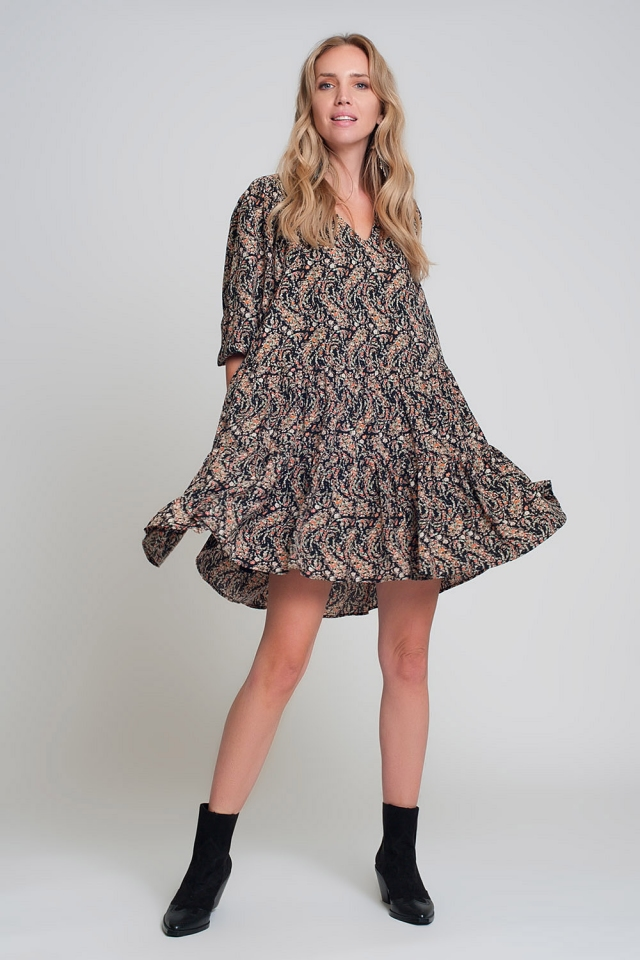 Black mini smock dress with puff sleeves, V-neck and geo print