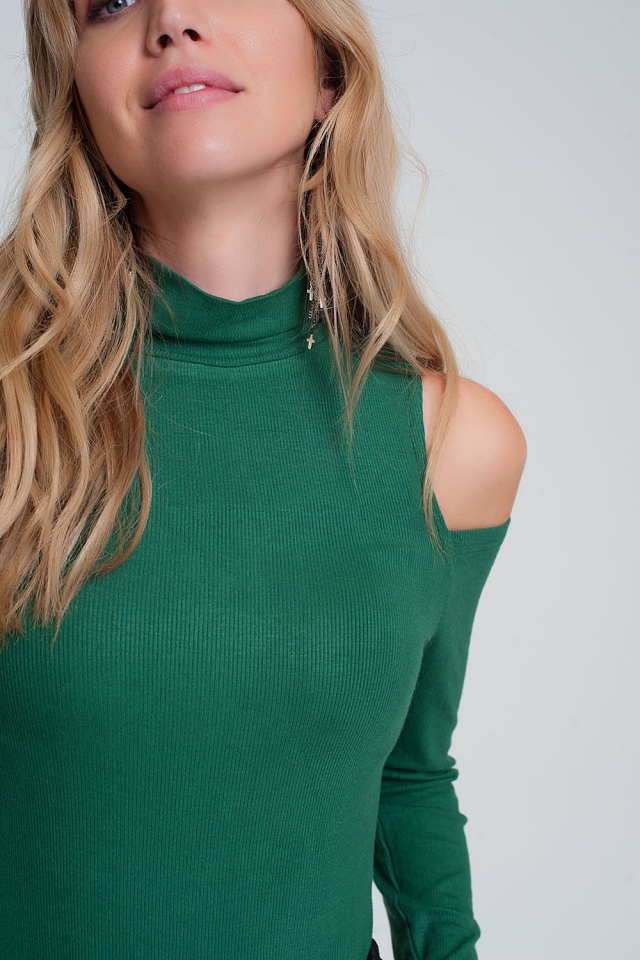 Green sweater with one open shoulder and high neck