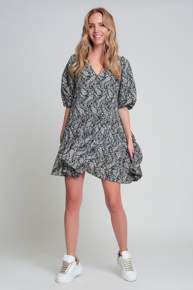 Green mini smock dress with puff sleeves, V-neck and geo print