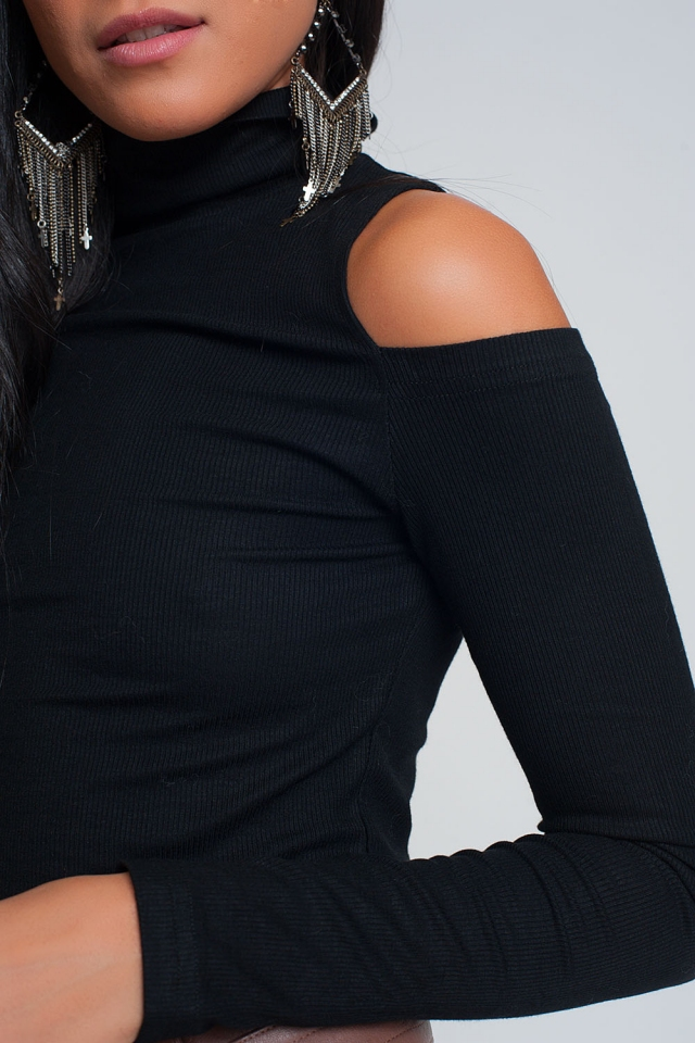 Black sweater with one open shoulder and high neck