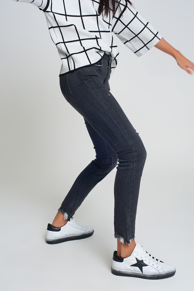 mid rise jeans in black with raw hem