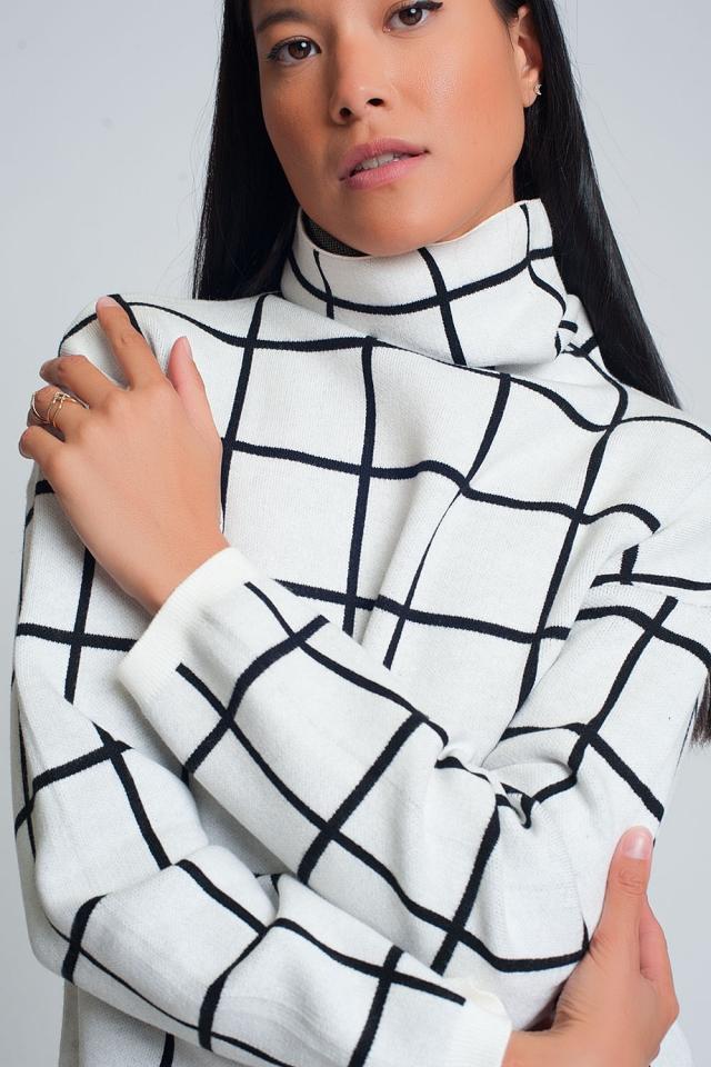 Checkered white turtleneck sweater