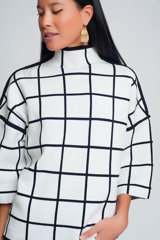 White sweater with chequered print in 3/4 sleeve and high neck