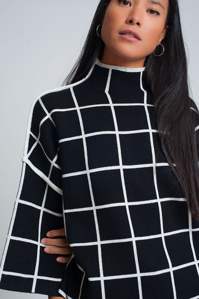 Black sweater with chequered print in 3/4 sleeve and high neck