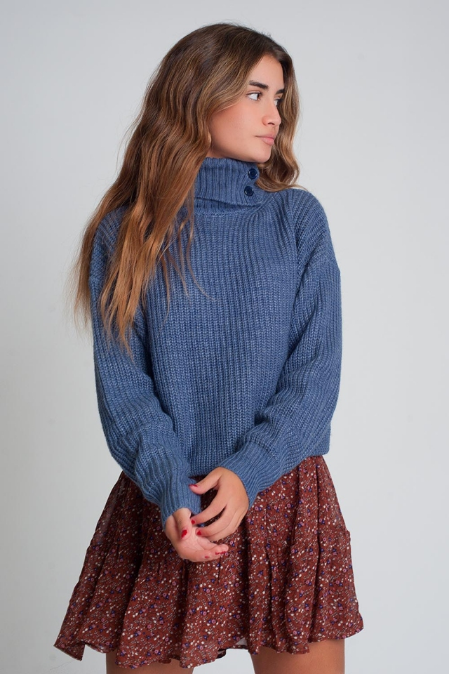 Knitted sweater with buttons and high collar in blue