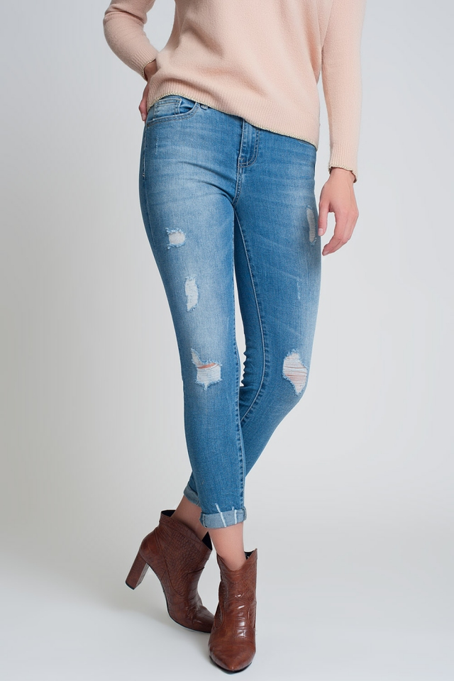 jeans in dark wash blue with heavy rips
