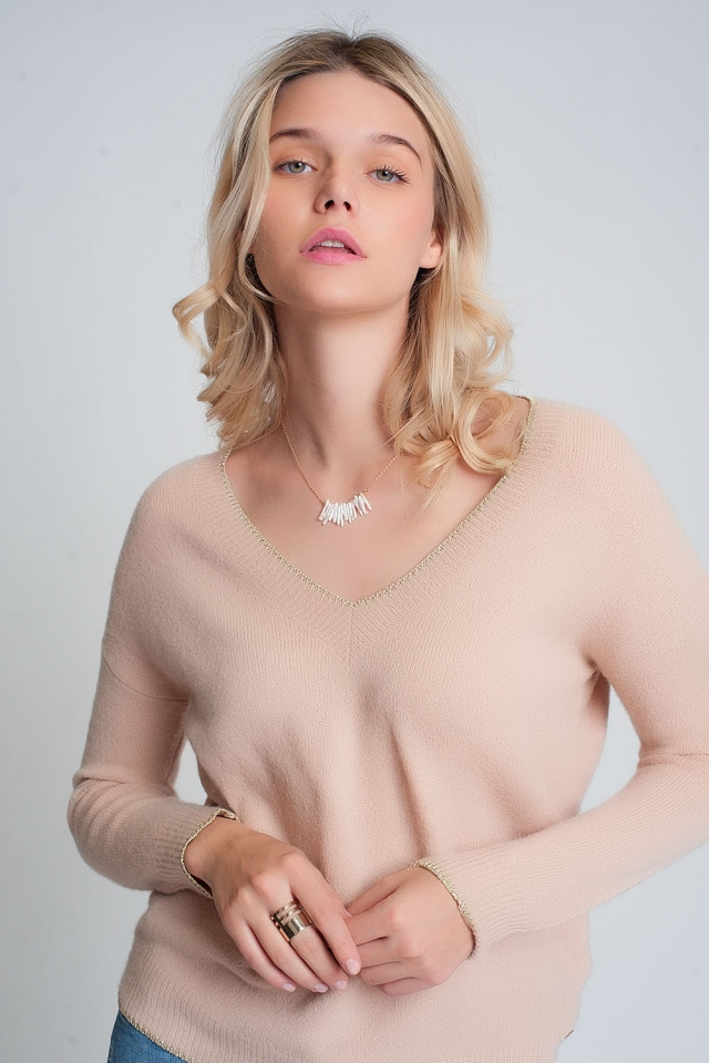 Pink sweater with long sleeves v neck with golden hem
