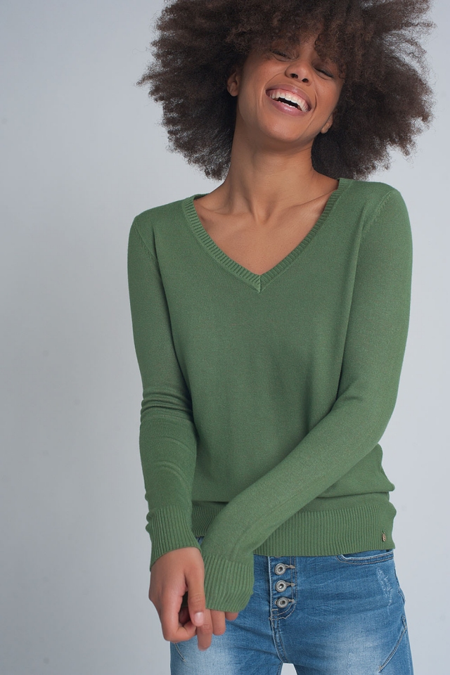 Soft basic sweater with green v-neck
