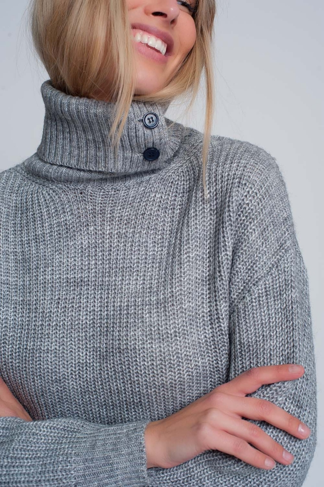Knitted sweater with buttons and high collar in gray