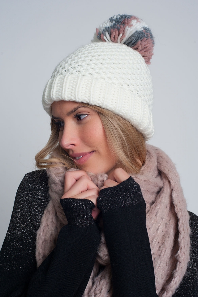 Textured knitted hat with yarn pom in cream