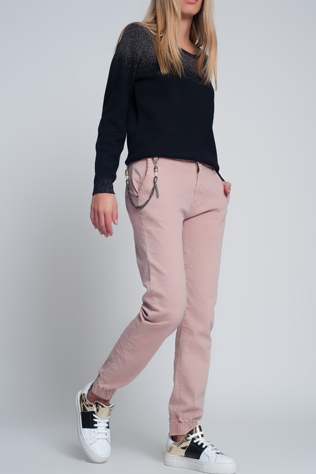 Cuffed utility pants with chain in pink